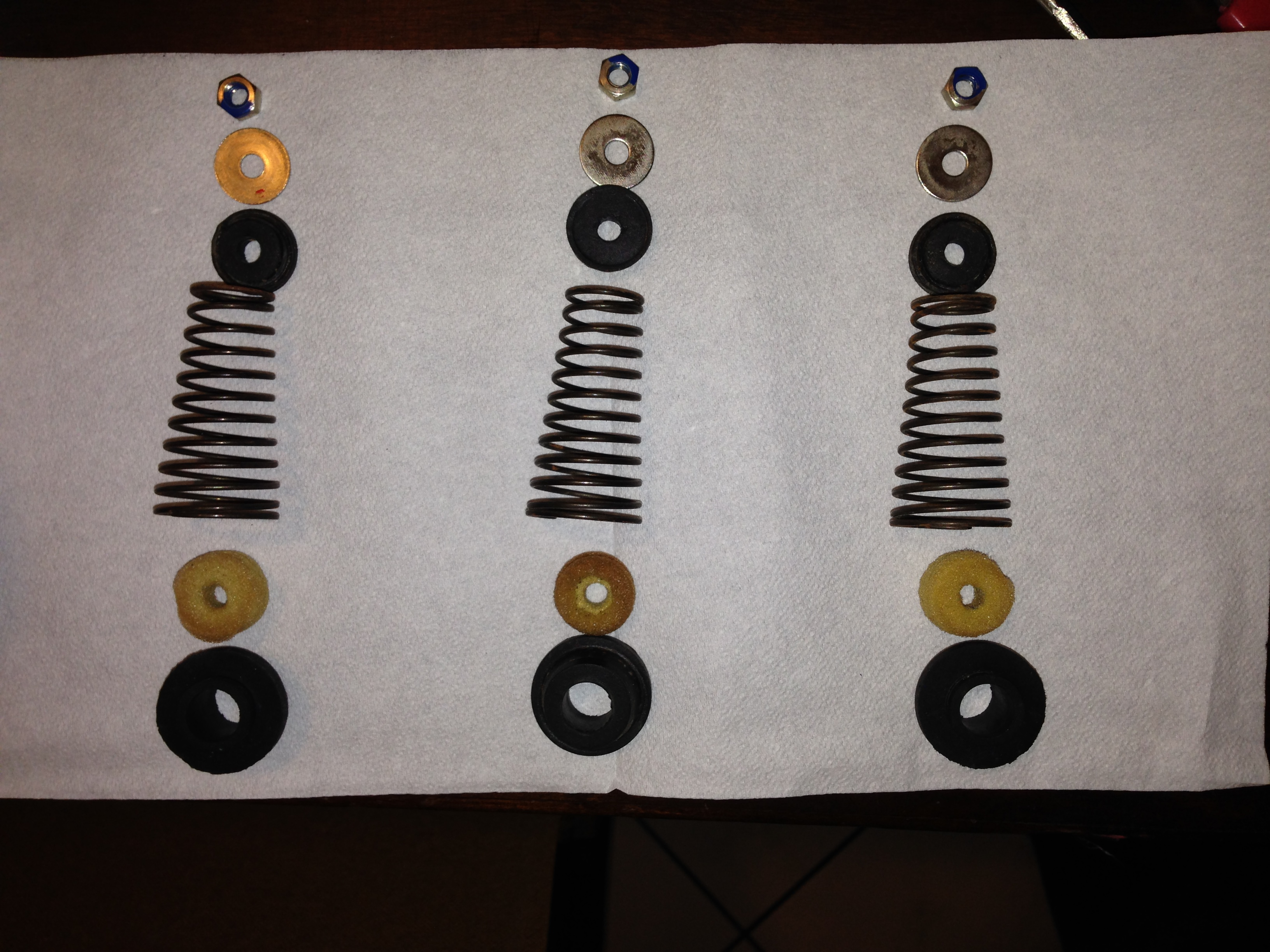 Spring assemblies made of springs, washers, grommets, and adjusting nuts - foam inserts are removed